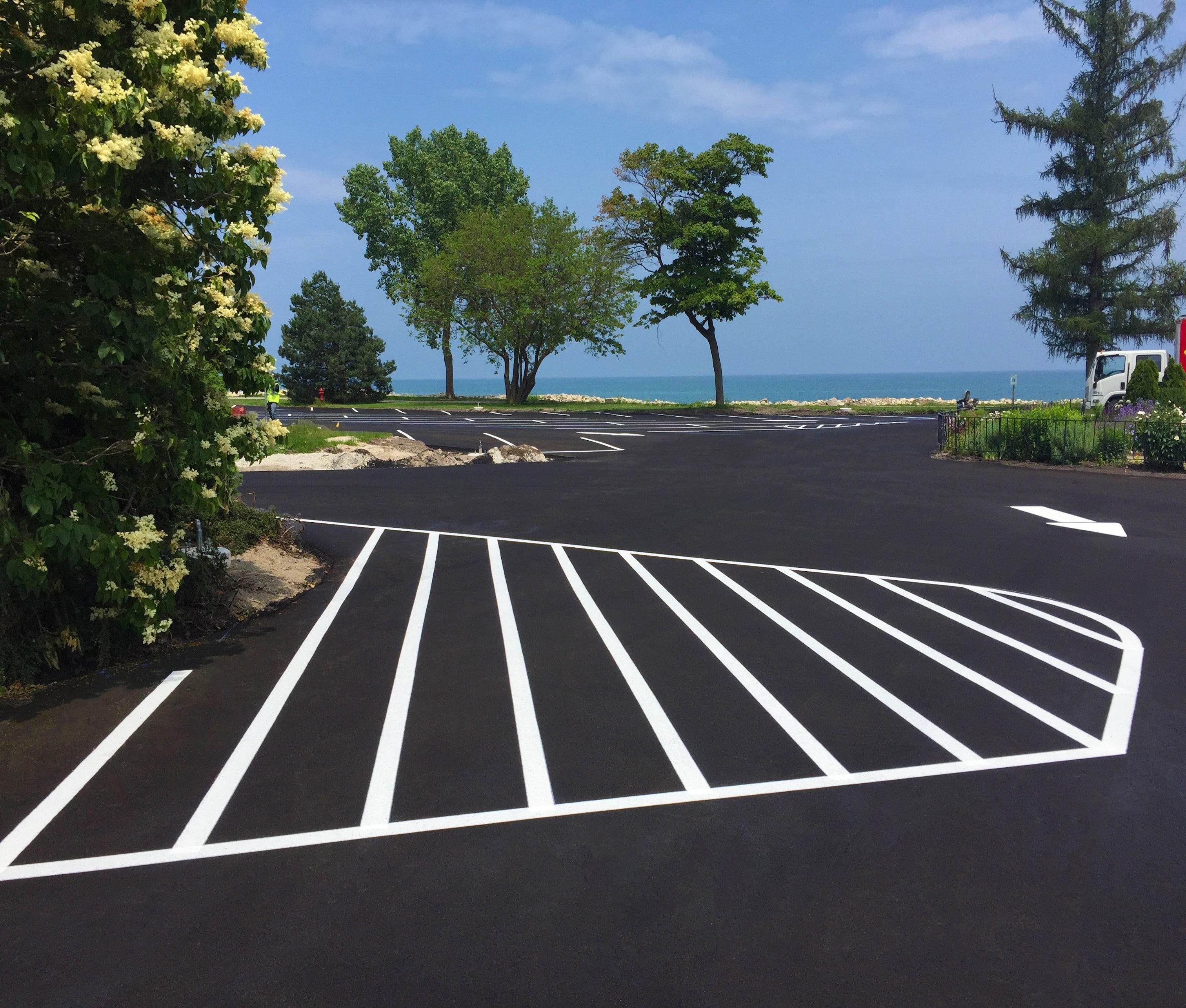 Sealcoat and line striping on the asphalt parking lot at Kemper Center.