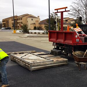 Infrared asphalt pothole repair on a commercial parking lot.