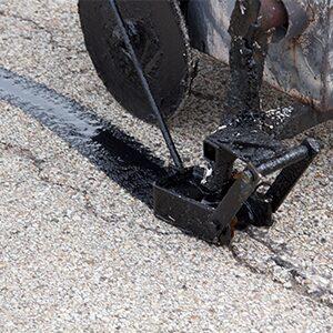 Crack repair on an asphalt driveway.