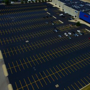 Pavement markings and line striping on commercial parking lot.