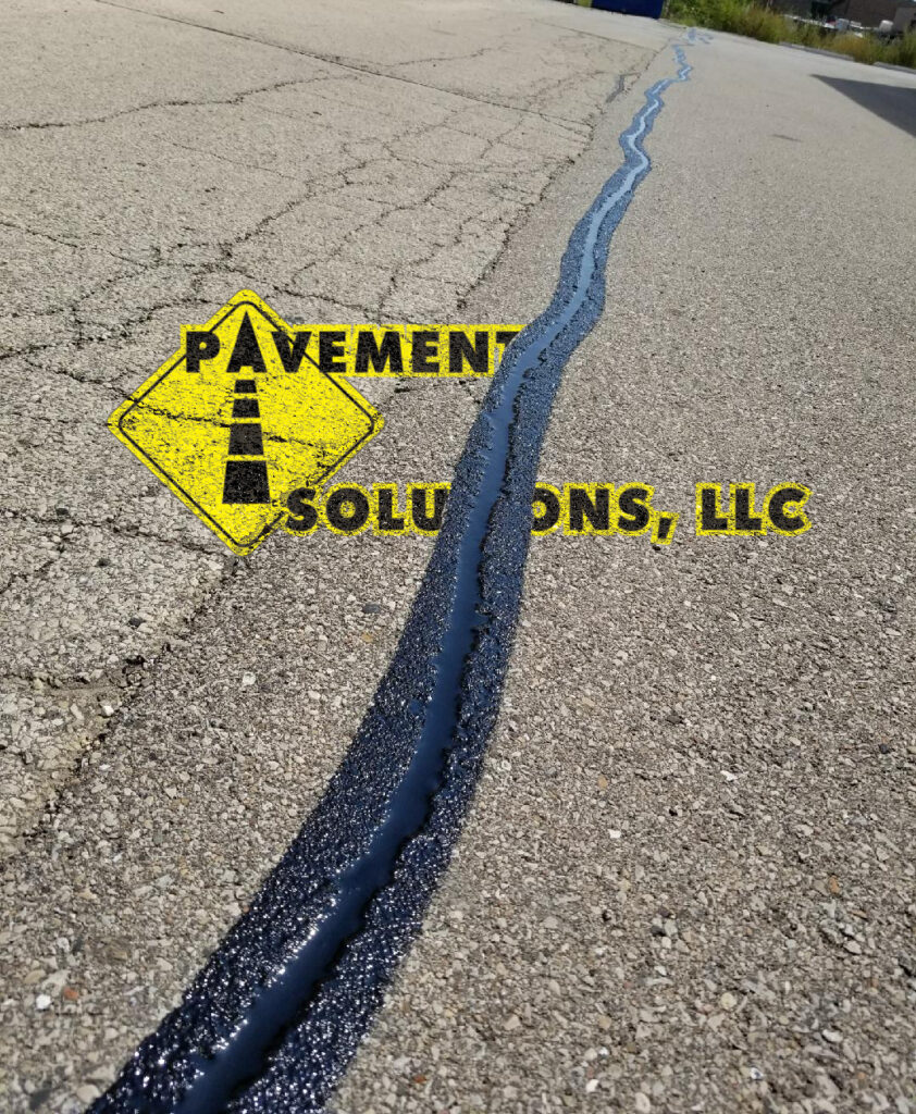 Crack sealing done by Pavement Solutions, LLC.